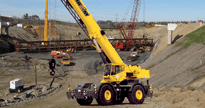 Pictured above is a rough terrain crane on a bridge project supporting both a crawler crane and an all terrain crane.
