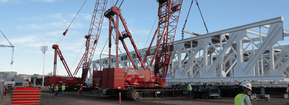 2 Manitowoc crawlers with customers beam