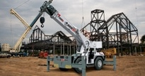 Pictured above is a sample of a carry deck crane. They are compact, mobile with telescoping booms and a load deck.